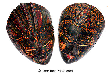 Two traditional indonesian mask on a white background. - Two...