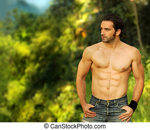 Fitness model outdoors - Outdoor portrait of a good looking...