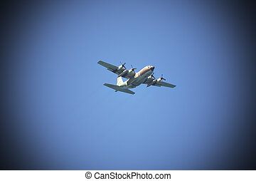 The plane - The military plane in the dark blue sky above...