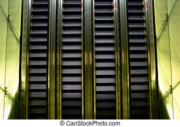 Escalator with sides lit up inside a shopping mall