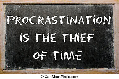 "Proverb ""Procrastination is the thief of time"" written on a..."
