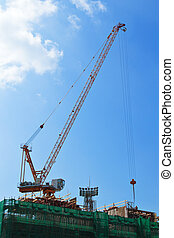 Crane and building construction site