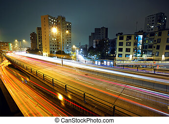 light trails on modern city at night