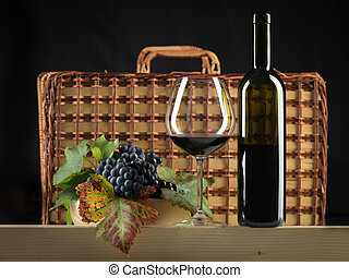 red wine bottle, glass, grapes, picnic basket - bottle of...