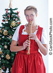 Young woman with flute - Young woman in traditional Bavarian...