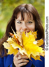 portrait of  woman  with maple posy