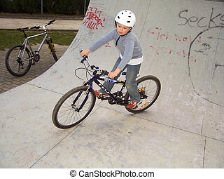 young boy with dirtbike in halfpipe - joung boy with his...