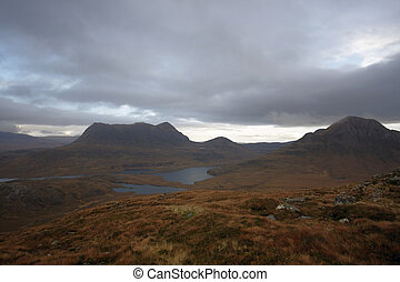 dramatic hilly landscape near Stac Pollaidh - clouded...