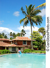 Swimming pool near villa at the popular hotel, Bentota, Sri...
