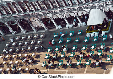 Venice, famous marcus place with cafe and tables with people...