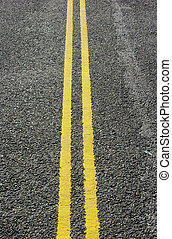Double yellow lines markings on road.