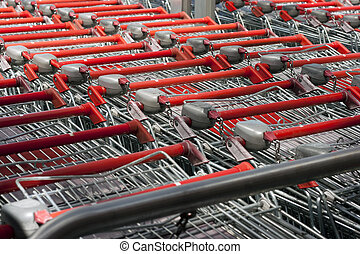 shopping carts  - red shopping carts in a row, close up