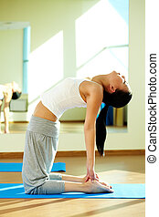 Flexibility - Portrait of young flexible girl doing physical...