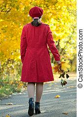 walking  woman in autumn park