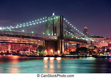 Urban bridge night scene - Brooklyn Bridge over East River...