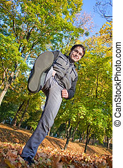 Young man doing kick to the camera - Young man in park doing...
