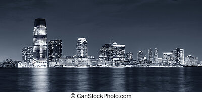 New Jersey - Jersey City skyline with skyscrapers at night...