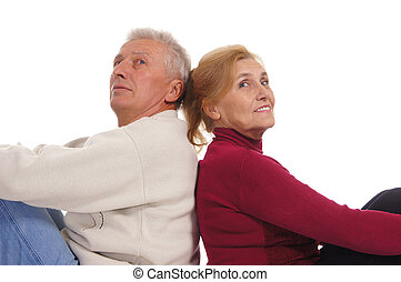 old couple portrait - cute elderly couple posing on a white