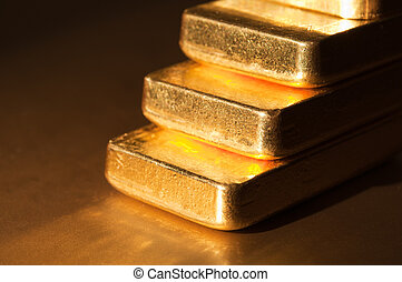 gold step - Stack fine gold ingots on a dark background....