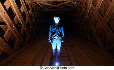 Hologram - A man who appears like a hologram in a tunnel