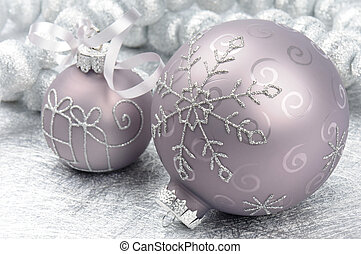 Christmas balls on the silver background