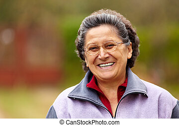 Cheerful senior lady outdoor - Closeup portrait of a...