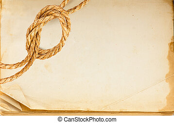 Old book page and hemp rope
