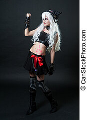 Girl in cosplay suit on black background