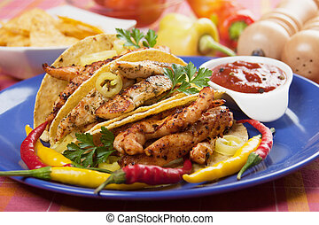 Grilled chicken meat in taco shells - Grilled chicken meat,...