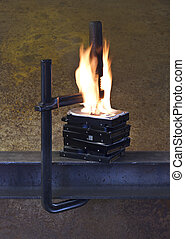 burning vise and hard disks - stack of hard disks pressed by...