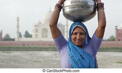 Indian Woman In Front of Taj Mahal
