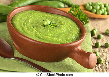 Fresh green pea soup in rustic bowl Selective Focus, Focus...