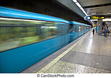 Train arriving in the station - blue Train arriving in the...
