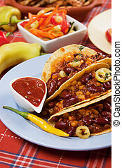Chili con carne burrito in taco shell - Chili con carne...