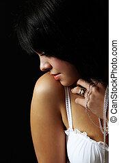 Boudoir - Beautiful brunette female in lingerie against...