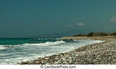 Aegean sea shore with pebble Rhodes island Greece