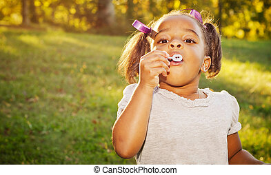 Young African-American girl playing in park