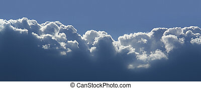 cloud in the sky - sunny illuminated cloud scenery in blue...