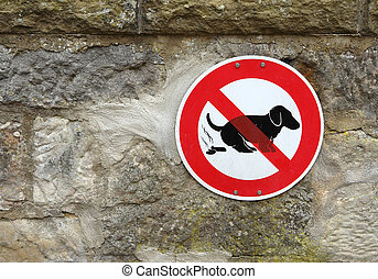 "dog shit sign - ""dog shit forbidden"" -sign on a stone wall"