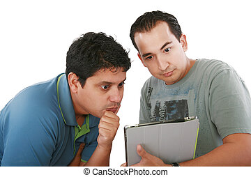 Two friends looking surprised at tablet computer against a white background