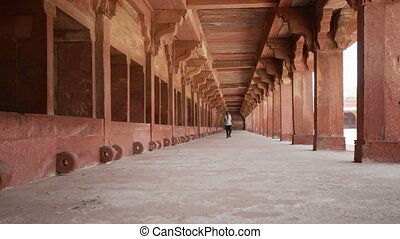 Man walking corridor Fatehpur Sikri - LS Indian Man walking...