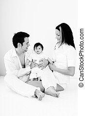 Family - A young happy family with their 4 month old son...
