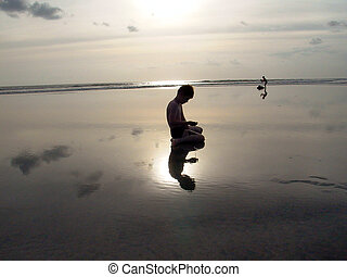 boy at the beach with Sunset and reflections - Sunset in...