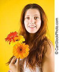 girl with flowers over yellow