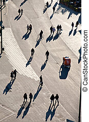 people walking in a pedestrian area seen from birds view,...