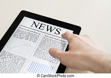 News On Tablet PC - Man hands are touching tablet pc with...