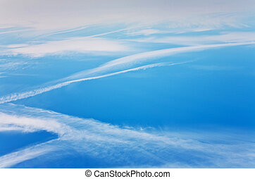 blue sky with condension trail of an aircraft