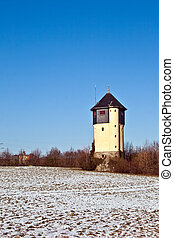 water tower in beautiful landscape with blue sky