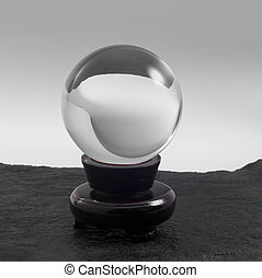 crystal ball on stand - a clear crystal ball with stand on...