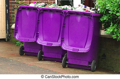 Recycling bins - Three full recycling bins in a row